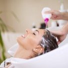 Portrait of women which wash hair in a beauty salon.Hairdresser washing hair.